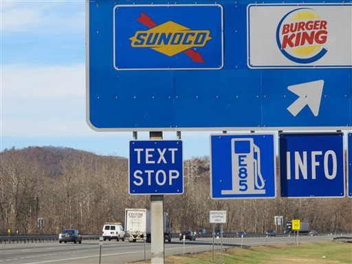 """A new """"text stop"""" notification is seen on a sign for a service area on the New York State Thruway in Sloatsburg, N.Y., on Thursday, Nov. 14, 2013."""