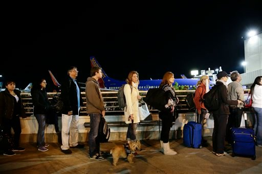 Travelers wait in line to check in at the Los Angeles International Airport on Wednesday, Nov. 27, 2013, in Los Angeles. More than 43 million people are to travel over the long holiday weekend, according to AAA. (AP Photo/Jae C. Hong)