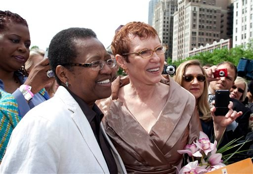 In this June 2011 photo provided by Starbelly Studios in Chicago, Vernita Gray, left, and Patricia Ewert smile during their civil union ceremony at Millennium Park in Chicago. (AP Photo/Courtesy of Starbelly Studios, Timmy Samuel)