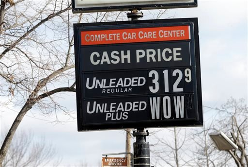 The cash price for unleaded fuel along with an editorial comment on unleaded-plus fuel was posted on a sign at a Minneapolis care care center Tuesday, Nov. 26, 2013, in Minneapolis. (AP Photo/Jim Mone)