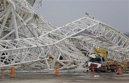 A collapsed metal structure sits on the ground at Itaquerao Stadium in Sao Paulo, Brazil, Wednesday, Nov. 27, 2013. (AP Photo/Nelson Antoine)