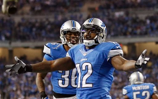 Detroit Lions wide receiver Jeremy Ross (12) reacts during the fourth quarter of an NFL football game against the Green Bay Packers at Ford Field in Detroit, Thursday, Nov. 28, 2013. (AP Photo/Rick Osentoski)