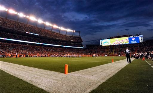 In this Aug. 29, 2013, photo, Sports Authority Field at Mile High stands under the lights during a preseason NFL football game between the Denver Broncos and the Arizona Cardinals in Denver.