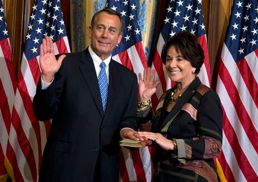 In this Jan. 3, 2013, file photo, Rep. Anna Eshoo, D-Calif., right, participates in a mock swearing-in ceremony with House Speaker John Boehner, R-Ohio, for the 113th Congress in Washington.