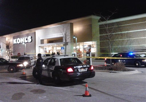 In this Nov. 28, 2013 photo police respond to a call at department store open on Thanksgiving in Romeoville, Ill., after an alleged shoplifting incident.