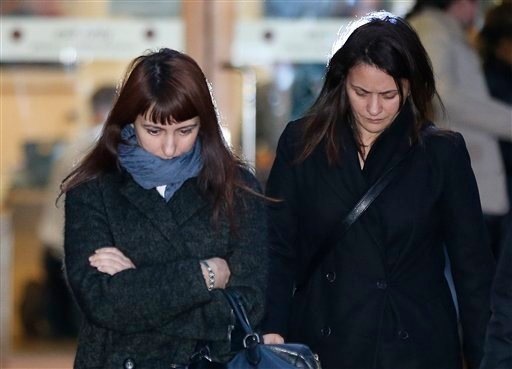 Italian sisters Francesca, left, and Elisabetta Grillo, right, former personal assistants (PA) to English broadcaster Nigella Lawson and her former husband art collector Charles Saatchi, leave the Isleworth Crown Court, in west London, Wednesday Nov. 27.