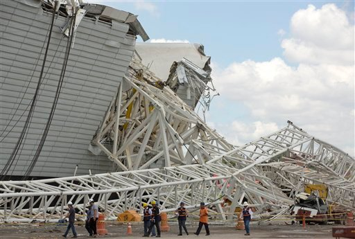 A buckled metal structure sits on a part of the Itaquerao Stadium in Sao Paulo, Brazil, Wednesday, Nov. 27, 2013.