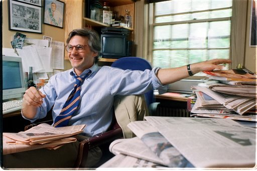 "In this Sept. 10, 2007 photo, New York Observer editor Peter Kaplan sits at his desk in New York City. Kaplan, who hired a then-unknown Candace Bushnell to write a column called ""Sex and the City,"" died Friday, Nov. 30, 2013, in New York, of cancer."