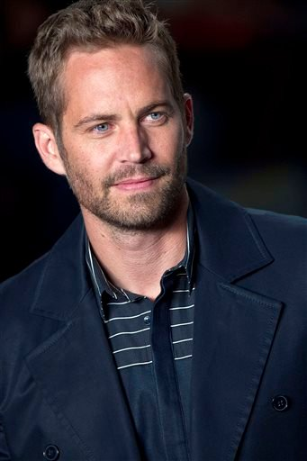 This March 21, 2013 file photo shows actor Paul Walker wearing a creation from the Colcci summer collection at Sao Paulo Fashion Week in Sao Paulo, Brazil.