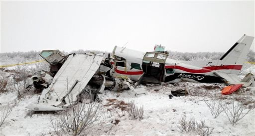 This image provided Saturday Nov. 30, 2013, courtesy of Alaska State Troopers shows the wreckage of a plane that crashed Friday near St. Marys, Alaska.