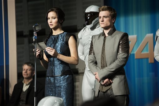 "This publicity photo released by Lionsgate shows Jennifer Lawrence, left, as Katniss Everdeen and Josh Hutcherson as Peeta Mellark in a scene from the film, ""The Hunger Games: Catching Fire."""