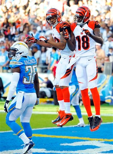 Cincinnati Bengals wide receiver A.J. Green (18) celebrates his touchdown with teammate wide receiver Marvin Jones.