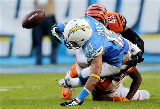 San Diego Chargers wide receiver Keenan Allen fumbles the ball as he is hit by Cincinnati Bengals strong safety George Iloka, above, and cornerback Adam Jones, below during the second half of an NFL football game Sunday, Dec. 1, 2013, in San Diego.