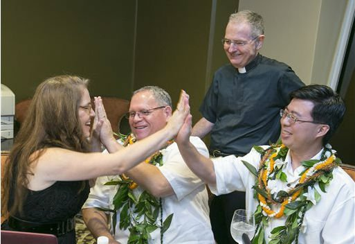 Hawaii became the 15th state to legalize same-sex marriage Monday, and couples were able to apply for marriage licenses after midnight. After receiving their marriage license, several couples held a group wedding at the hotel. (AP Photo/Marco Garcia)
