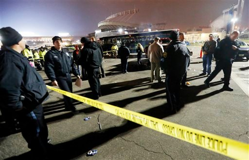 Kansas City, Mo. police work a crime scene in parking lot A outside Arrowhead Stadium, in Kansas City, Mo., after a person was killed Sunday, Dec. 1, 2013.