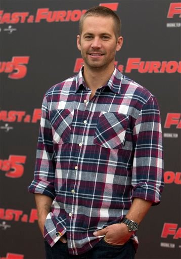 """In this April 29, 2011 file photo, actor Paul Walker poses during the photo call of the movie """"Fast and Furious 5,"""" in Rome."""