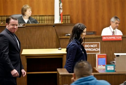 Cecilia Abadie, right, leaves the courtroom followed by her attorney William M. Concidine after an appearance at traffic court Tuesday, Dec. 3, 2013, in San Diego.