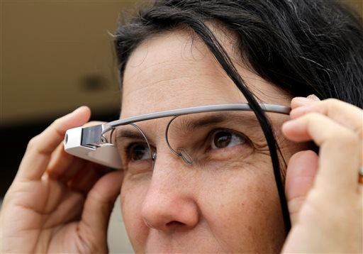 Cecilia Abadie models her Google Glass as she talks with her attorney outside of traffic court Tuesday, Dec. 3, 2013, in San Diego.