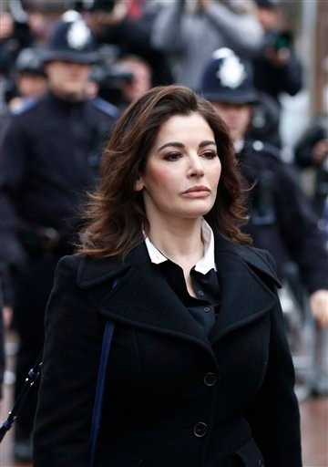 Celebrity chef, Nigella Lawson, arrives at Isleworth Crown Court in London, Wednesday, Dec. 4, 2013.