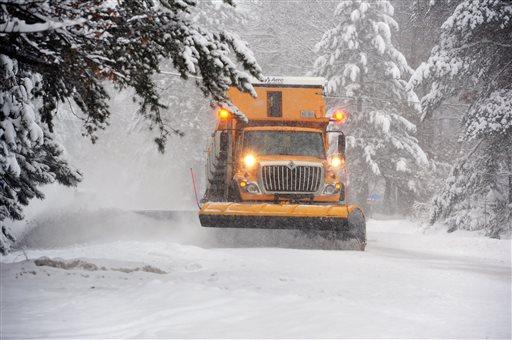 A Crow Wing County snowplow operator clears snow near Merrifield, Minn., Wednesday, Dec. 4, 2013. (AP Photo/The Brainerd Daily Dispatch, Steve Kohls)