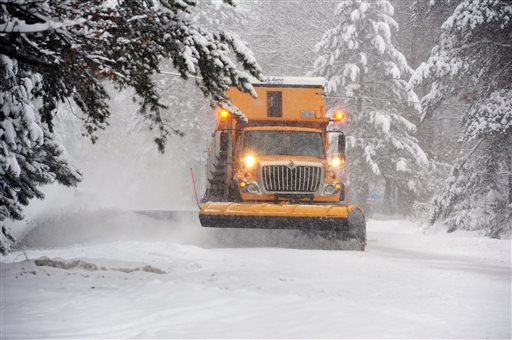 A Crow Wing County snowplow operator clears snow near Merrifield, Minn., Wednesday, Dec. 4, 2013. (AP Photo/The Brainerd Daily Dispatch, Steve Kohls)