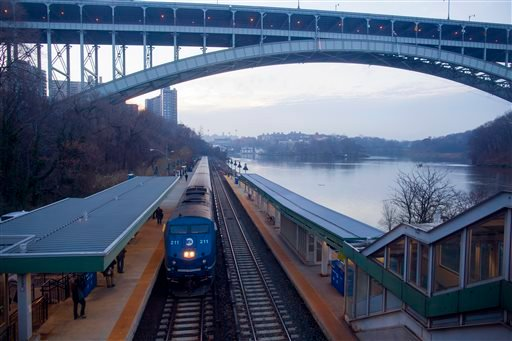 Metro-North passenger train pulls into Spuyten Duyvil station in the Bronx borough of New York Dec. 4, 2013, a few hundred feet before a curve where a fatal derailment disrupted service Dec. 1. (AP Photo/Craig Ruttle)