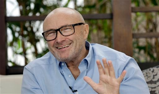 British musician Phil Collins, smiles as he talks to a reporter, Wednesday, Dec. 4, 2013, in Miami Beach, Fla.