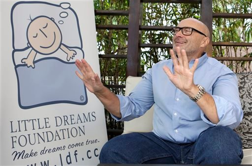 British musician Phil Collins gestures as he talks to a reporter about his Little Dreams Foundation, Wednesday, Dec. 4, 2013, in Miami Beach, Fla.