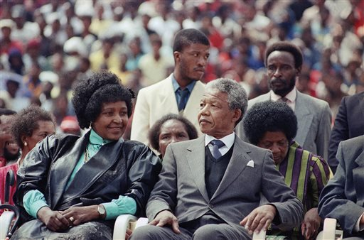 FILE - In this Feb. 13, 1990 file photo, Nelson Mandela, right, with his wife, Winnie, participate in a South African Communist Party Rally in the fully-packed Soccer City stadium in Soweto, South Africa, shortly after his release from 27 years in prison.