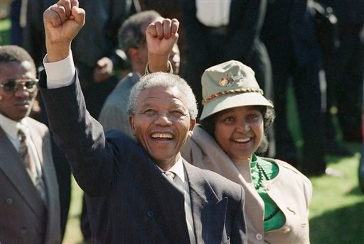 FILE - In this July 7, 1991, file photo, newly-elected African National Congress President Nelson Mandela and his wife, Winnie, greet the crowd after arriving at a rally and a week-long national ANC conference. (AP)