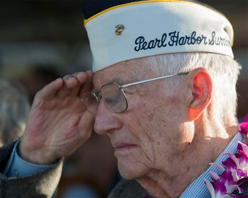 Pearl Harbor survivor John R. Stevens salutes the flag at the start of ceremony commemorating the 72nd anniversary of the attack on Pearl Harbor, Saturday, Dec. 7, 2013, in Honolulu. (AP Photo/Marco Garcia)