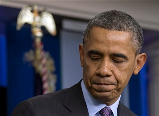 U.S. President Barack Obama turns from the podium after speaking in the briefing room of the White House in Washington, Thursday, Dec. 5, 2013, about the death of Nelson Mandela.