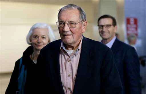 Merrill Newman, center, walks beside his wife Lee, left, and his son Jeffrey after arriving at San Francisco International Airport on Saturday, Dec. 7, 2013.