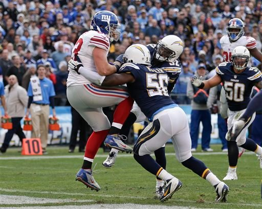 New York Giants tight end Brandon Myers pulls in a 5-yard touchdown pass against the San Diego Chargers during the second half of an NFL football game on Sunday, Dec. 8, 2013, in San Diego.