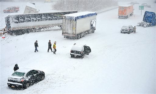 Trucks, trailers, and cars litter southbound lane of Interstate 81 at Salem Ave. Sunday, Dec. 8, 2013.