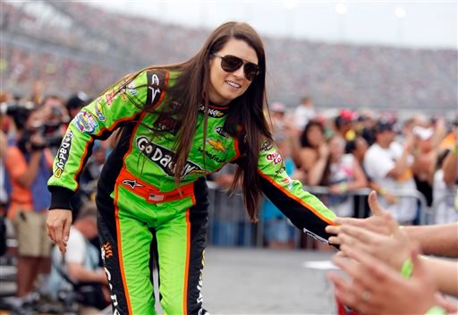 In this May 11, 2013 file photo, driver Danica Patrick high fives fans during driver introductions before the start of the NASCAR Sprint Cup series auto race at Darlington Raceway, in Darlington, S.C.