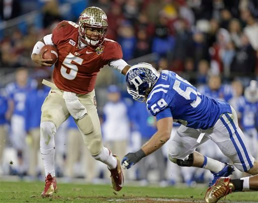 Florida State's Jameis Winston (5) scrambles as Duke's Kelby Brown (59) defends in the first half of the Atlantic Coast Conference Championship NCAA football game in Charlotte, N.C., Saturday, Dec. 7, 2013.