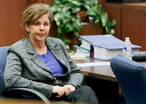 FILE - In this Oct. 23, 2013, file photo, former assistant city manager of Bell, Calif., Angela Spaccia, who is charged with misappropriation of public funds and other counts, listens to opening statements in Los Angeles Superior Court. (AP)