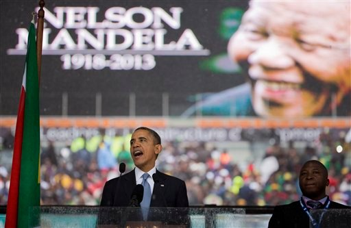 President Barack Obama speaks to crowds attending the memorial service for former South African president Nelson Mandela at the FNB Stadium in Soweto near Johannesburg, Tuesday, Dec. 10, 2013.