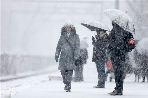 Commuters wait on a train during a winter snowstorm Tuesday, Dec. 10, 2013, in Philadelphia.