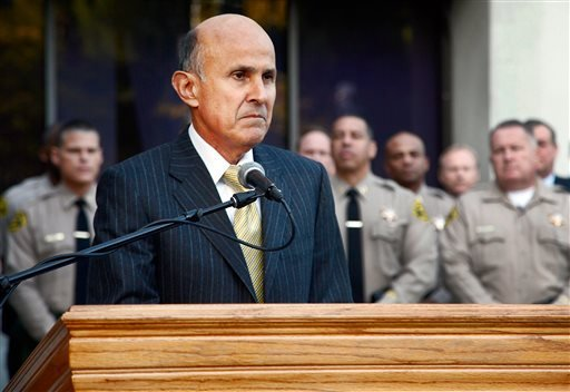 Los Angeles County Sheriff Lee Baca takes questions from the media after the FBI released results of a federal probe, Monday, Dec 9, 2013 at a news conference in Los Angeles.