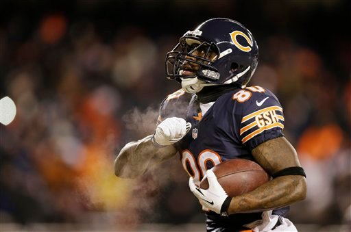 Chicago Bears wide receiver Earl Bennett (80) celebrates after making a touchdown reception during the first half of an NFL football game against the Dallas Cowboys, Monday, Dec. 9, 2013, in Chicago. (AP Photo/Nam Y. Huh)