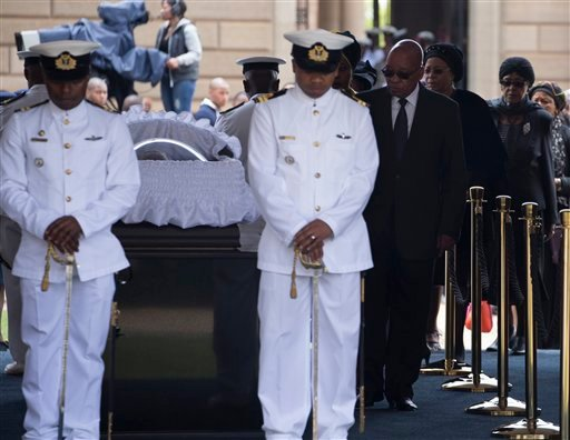 South African President Jacob Zuma pays his respects to former South African President Nelson Mandela during the lying in state at the Union Buildings in Pretoria, South Africa, Wednesday, Dec. 11, 2013.(AP Photo/Marco Longari, Pool)