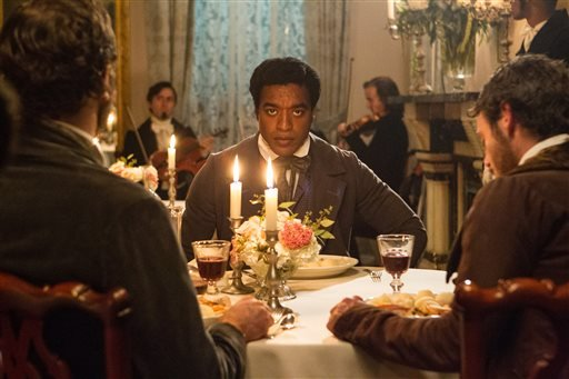 """This film publicity image released by Fox Searchlight shows Chiwetel Ejiofor in a scene from """"12 Years A Slave."""" The Golden Globes nominations will be announced on Thursday, Dec. 12. (AP Photo/Fox Searchlight Films, Jaap Buitendijk)"""
