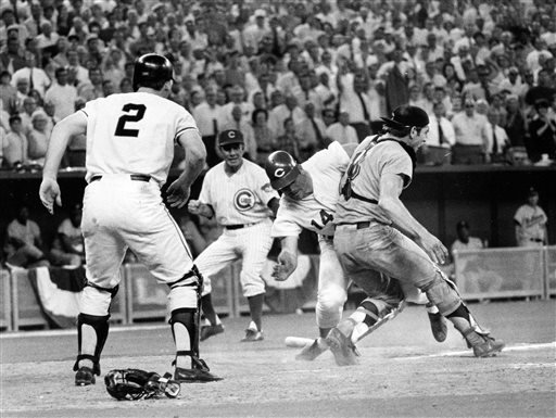 In this July 14, 1970 file photo, Cincinnati Reds' Pete Rose (14) slams into Cleveland Indians' catcher Ray Fosse to score a controversial game-winning run for the National League team in the 12th inning of the 1970 All-Star game in Cincinnati.