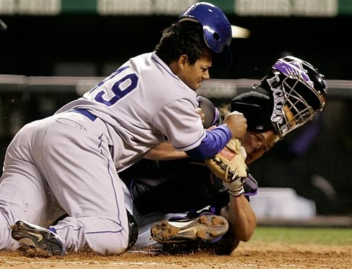 In this Sept. 27, 2006, file photo, Los Angeles Dodgers' Delwyn Young, left, is out at home plate as he collides with Colorado Rockies catcher JD Closser during the seventh inning of a baseball game in Denver.