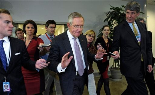 Senate Majority Leader Harry Reid of Nev., center, is pursued by reporters on Capitol Hill in Washington, Wednesday, Dec. 11, 2013. (AP)