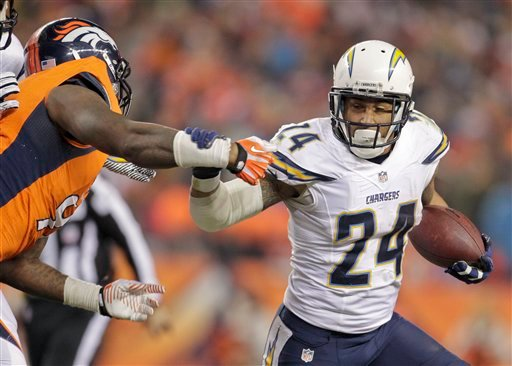 San Diego Chargers running back Ryan Mathews (24) brushes off Denver Broncos defensive end Robert Ayers (91).