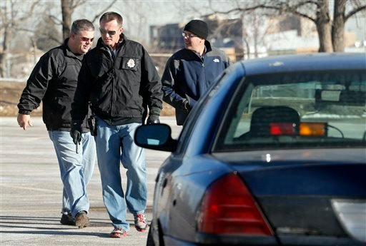 Denver Police detectives investigate the scene of a stabbing on Friday, Dec. 13, 2013, in a parking lot adjacent to Sports Authority Stadium where three people were stabbed during a fight after an NFL football game between San Diego and Denver on Thurs.