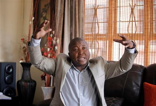 Thamsanqa Jantjie gesticulates at his home during an interview with the Associated Press in Johannesburg, South Africa,Thursday, Dec. 12, 2013.